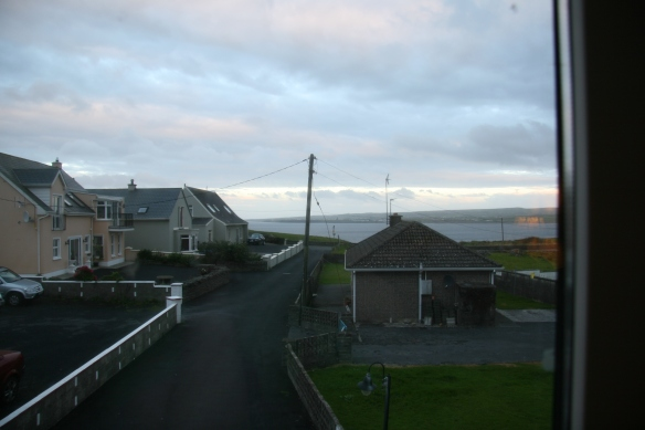 Not that I mind. I get to see the sunrise most days. This is the view from our window at Craglea Lodge in Lahinch. All three homes on the left side (one you can't see) belong to Kennys.