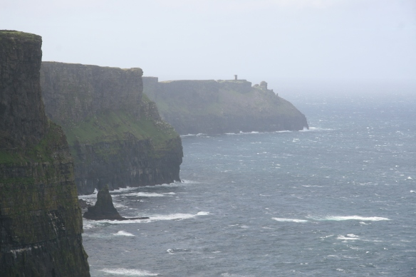 There are paths along the top of the cliffs; you can walk all the way out there to Hag's Head, which has a Napoleonic-era watchtower; you can see it here in this zoom photo. I think it's a couple miles in that direction (south).
