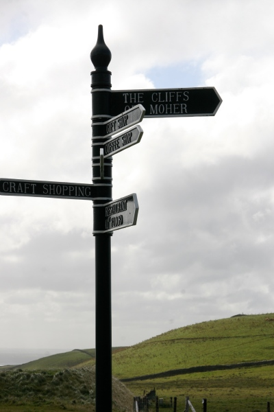 Look, honey! The Cliffs of Moher—thataway! Thank goodness they've got this sign—we'd never have found them!