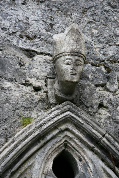 The bishop in his mitre, right above the sedile. He looks rather determined, don't you think?