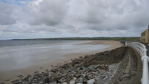 Lahinch beach at low tide. You can see Liscannor (pop. 71) across the bay.