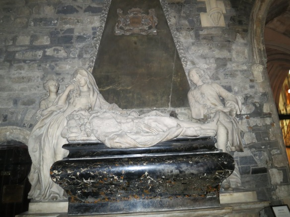 There are a few monuments in Christ Church too. This one is for Robert FitzGerald, the 19th Earl of Kildare, who died at age 68 and was apparently outlived by his wife. One wonders how idealized these stone portraits are. The man's bio is presented on etched stone underneath this black marble pedestal. (Margaret's photo.)
