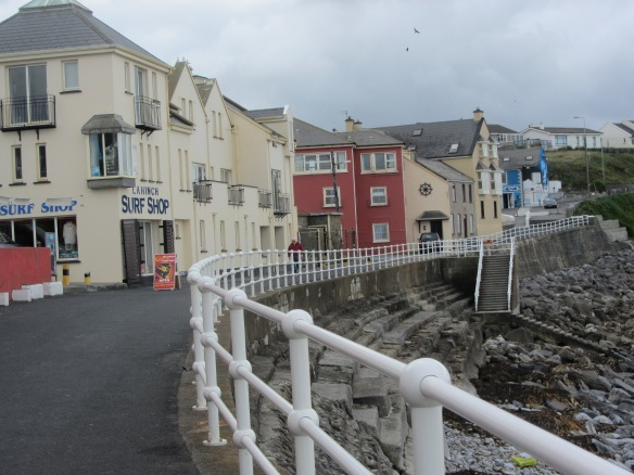It's not exactly a boardwalk any more, but there are several shops along the ocean in Lahinch. The Celtic T-Shirt Shop is just out of the shot on the left. (Jill's photo.)