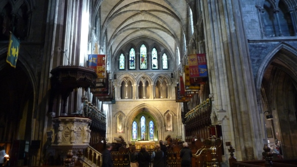 Looking at the altar at St. Patrick's, and beyond it (under the arch), the Lady Chapel. Note all the flags.