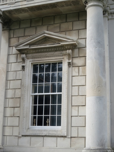 This window appears to serve three rooms, one on the upper floor. You can see the curved panes. (Margaret's photo.)