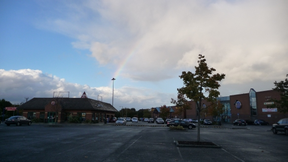 When we got out of the car at the theater, I made everyone wait while I got the camera—I'd seen our fourth rainbow!