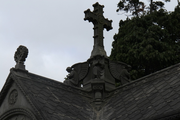 Detail of the roof of a memorial with finials and praying angels. (Remember, click on the photo twice to zoom in.)