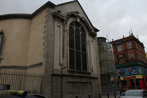 0428 It's a lovely building. This would have actually been the back side of the church, with the front door opposite these stained-glass windows. I'm sorry now that I didn't walk around to the back to have a look.