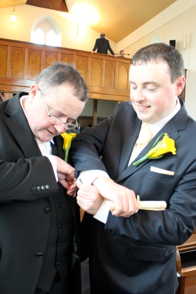 William (father of the groom) and Neil showing off their cufflinks before the ceremony.