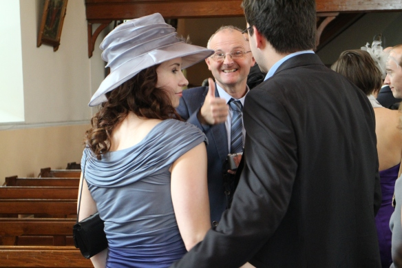 Now we all leave the church and stand around outside. Here Richie Hampson, uncle of the groom, gives a thumbs-up.