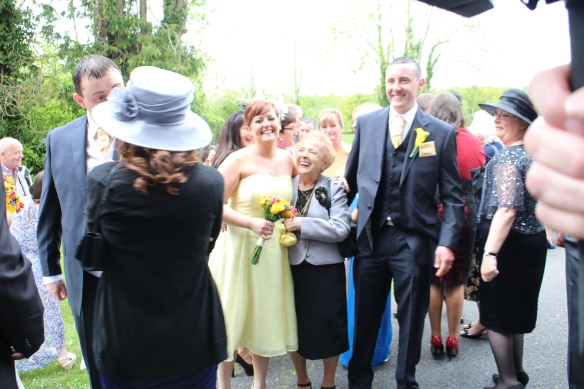 The traditional standing-around-outside. In the center here, Clare Hampson, sister of the groom, Bridie Hampson, gramother of the groom, and Eoin Hampson, brother of the groom. It was freezing out there!
