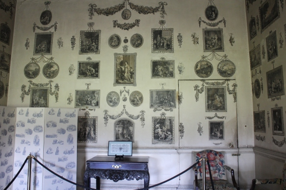 The print room at Castletown House. The screen in the lower left is one of the modern works of art on exhibition. The prints are nineteenth-century engravings of Irish eviction and famine paintings, printed on low-grade cotton cloth to subtly juxtapose the relationship between rich and poor.