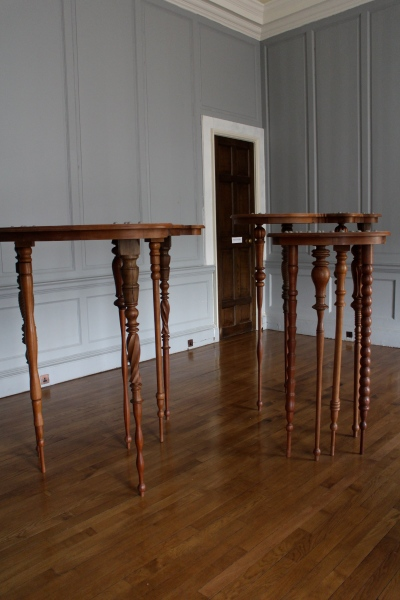 Another modern art installation, ornate—but very tall—tables that seem to mimic the eighteenth-century furniture we see throughout the house.
