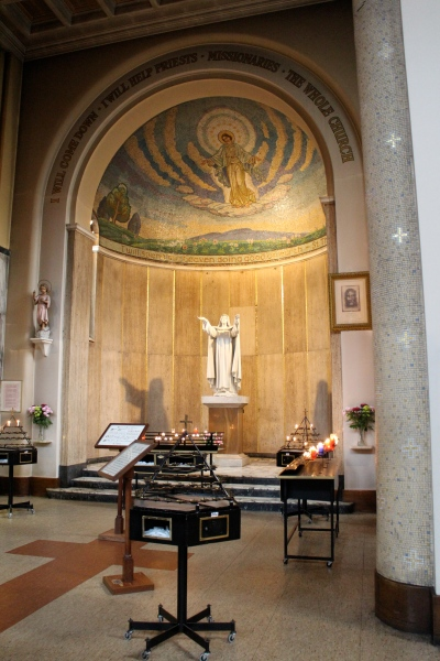 "The shrine of St. Thérèse of Lisieux, built in the mid-1950s, also includes a beautiful mosaic of ""Our Lady of the Smile"" (that is, the Virgin Mary, whose smile Thérèse is said to have seen)."