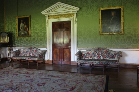 The green drawing room at Castletown House. The portrait on the right is Speaker Conolly; the one on the left is his wife, Katherine, and her niece.