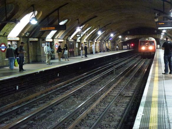 A Hammersmith and City Line train for Barking arrives at one of Baker Street's two oldest platforms. (From Wikipedia.)