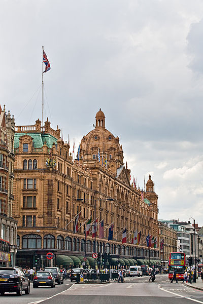 Harrods department store as viewed from the north-east along Brompton Road, in London, England. (From Wikipedia, this photo is by DAVID ILIFF. License: CC-BY-SA 3.0.)