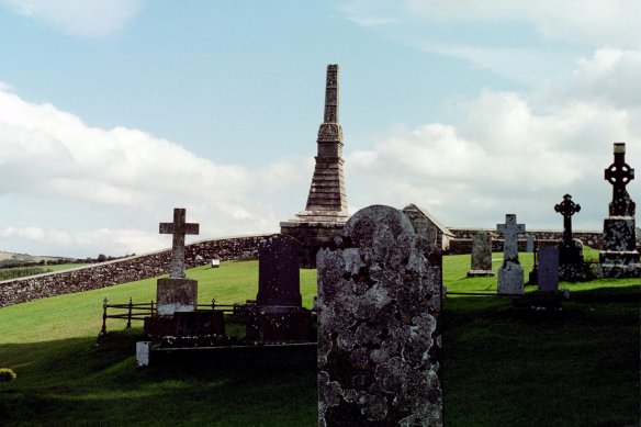 "The churchyard at the Rock of Cashel, late afternoon. Note that ""monument"" at the back would have been a cross at some point."
