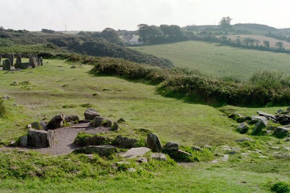 Foreground left, remains of a hut; the cooking pit is on the right. The stone circle can be seen in the background.