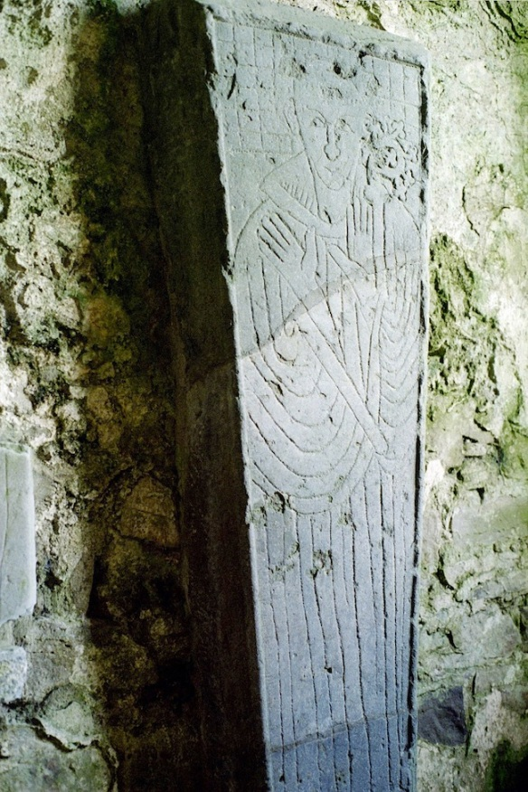 This is one of those slab carvings. It may be Felix O'Dulany, who was a bishop of Ossory (the diocese); you can see his crozier. It dates from 1202.