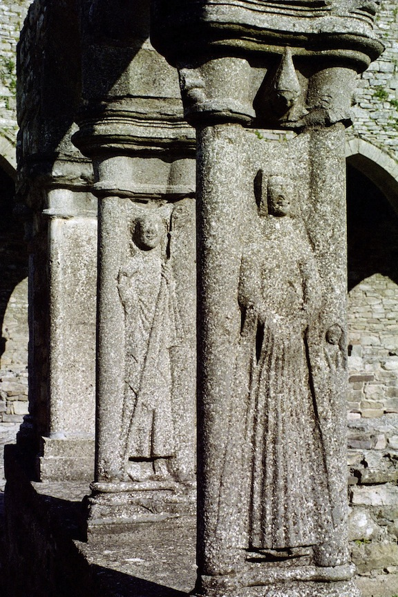 The cloister walk was lined with carving after carving. Look above the monk in the foreground: is that another head looking down on him?
