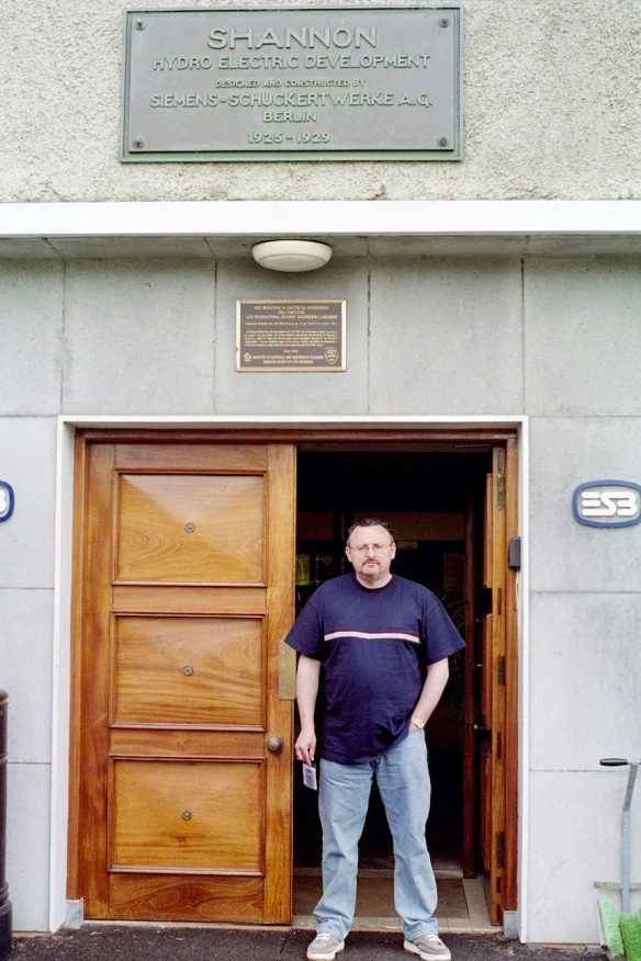 Gerry in the doorway at Ardnacrusha. Note the beautiful wooden door and the brass plaque above it.