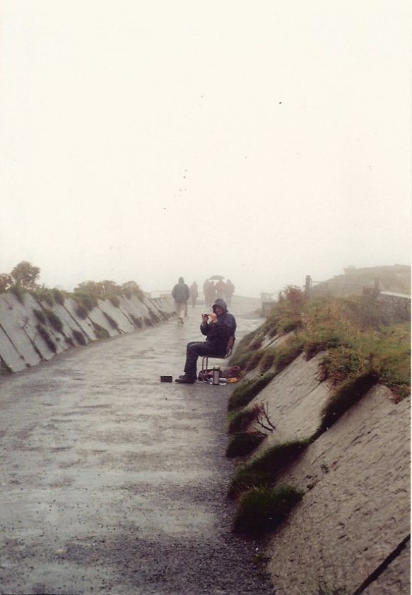 This is the path to the edge of the cliffs. Even on a rainy day there was a busker, playing his tin whistle. Cliffs of Moher 2003.