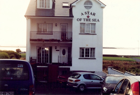 Our B&B, right across from Galway Bay, 2003. Looks small, doesn't it! And yet there are six suites plus a kitchen and dining room. (Count the cars in the parking area and you'll believe me.) We had one of the claustrophobic basement rooms.
