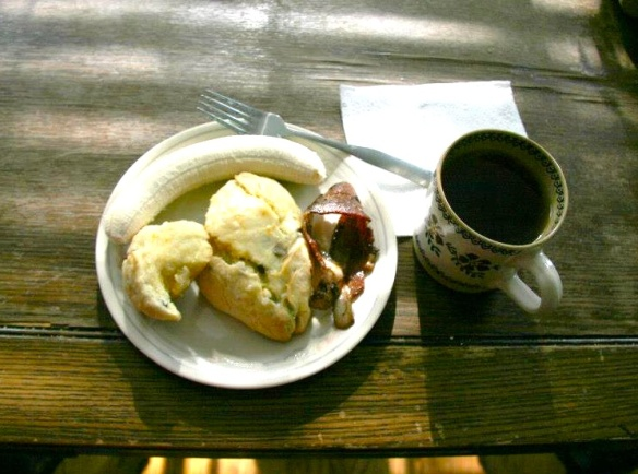 Breakfast: banana, scone, bacon … and a cup of brown joy. :)