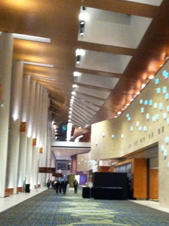 The event is held in the Music City Center. This is the long hall down which guests approached us. I was fascinated by the way the angle of the skylights in the ceiling tilt.