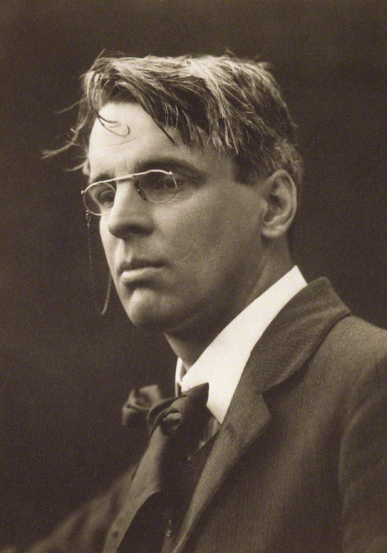 William Butler Yeats (age 46) by George Charles Beresford, 15 July 1911 © National Portrait Gallery, London; obtained under a Creative Commons license.