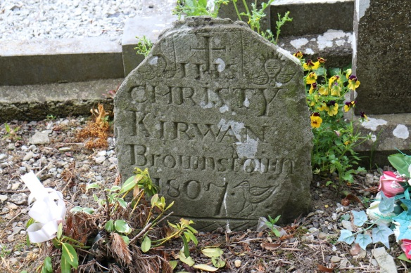 Here's a stone that's more than 200 years old: Christy Kirwan died at Brownstown in 1807. At the top a Christogram—IHS—flanked by angels. I'm not sure if the bird below is meant to be a dove; it looks like a sea bird.