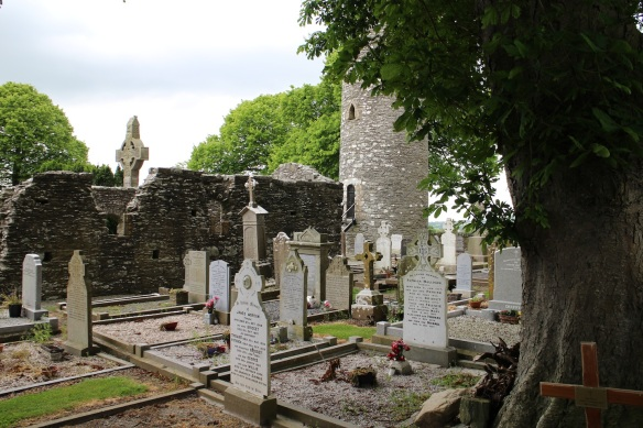 In the foreground, much newer gravesites, but you can see remains of the church, the tower, and at the rear, one of the historic crosses.