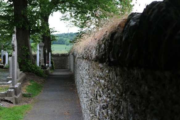 The wall that surrounds it is newer than the site of the graves and church.