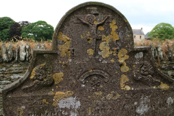 This old stone was impossible to read, but you can make out Christ on the cross, two tilted angels … and a skull and crossbones. This is a memento mori—a symbolic reminder that we all will die.