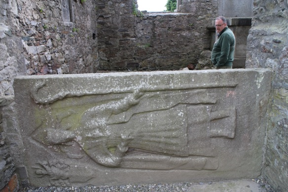 At some point this effigial tomb slab was set on its side to keep it from breaking or being walked upon (as tourists sometimes do). At one time it lay flat on top of a box that contained the remains of James Cusack, bishop of Meath 1679–1688.
