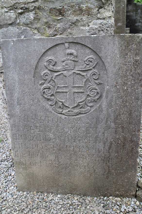 This one reads: This stone and burial / place belongeth to / Richard Purfield and / his posterity who dep- / this life the 16 of Feb'ry in the year / of Lord 1733. Aged 33 years. The escutcheon is interesting too. Is that a dog? a deer? above the helmet?