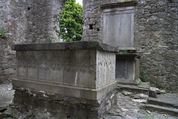 Some websites have called this an altar but I believe it is a box tomb. The top lifts off. You'd be someone important, to get a grave like this, above ground. Note the gravestone embedded in the wall at the rear, which lists a dozen or more burials, all from the early 1700s.