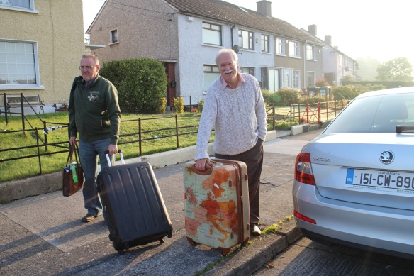 Gerry and John, unloading my bags. I came with two but consolidated to one for the trip 'round Ireland.
