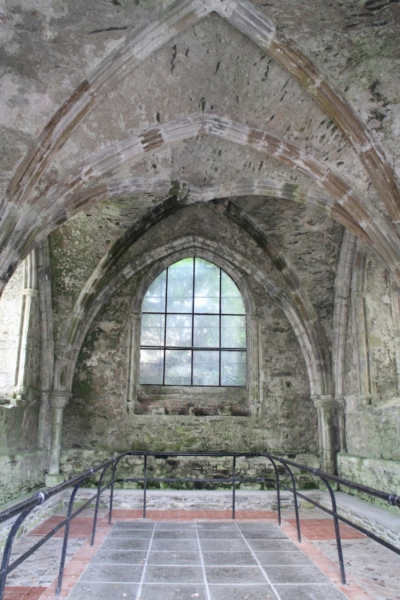 Looking inside the chapter house. Those are medieval-era glazed tiles on the floor that originally were in the church.