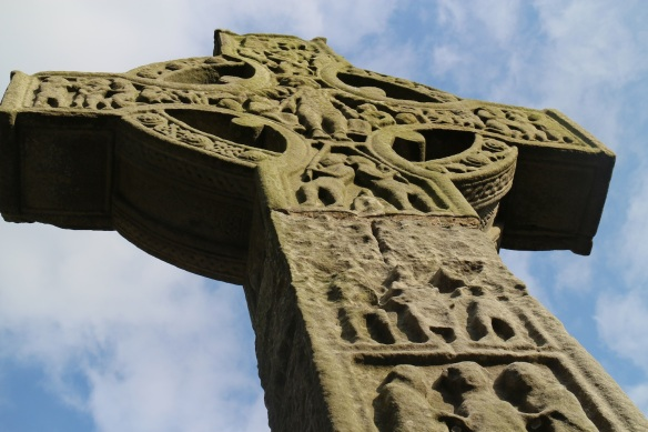 This is the west side of the Tall Cross. Although this is a crucifixion scene, Christ is fully clothed in a long-sleeved garment.