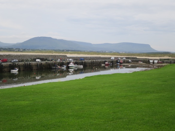 With a magnificent view of Ben Bulben. Don't these trucks and boats look like toys?