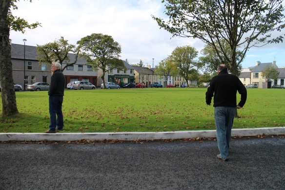 John and Gerry getting ready to walk across the green to the grocer (in search of green teabags).