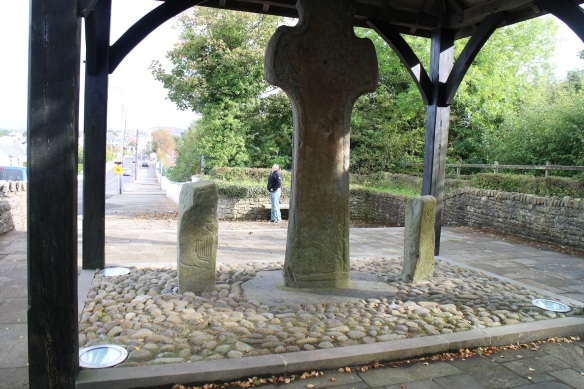 This is the other side of the Carndonagh Cross, flanked by the two pillar stones, with Gerry in the background. You can see in the pillar stones, how the artist would simply use unshaped (or barely shaped) stone, upon which he'd scratch out a drawing. That's King David with his harp on the left.