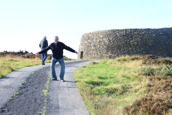Gerry climbing the hill to the fort; John behind him.
