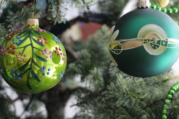 I purchased the glass ornament on the right during my first trip to Ireland in 2003. It is hand painted.
