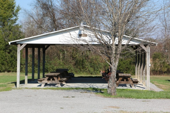 A pavilion with picnic tables. It's called the Pastor Milton & Mrs. Bobbie Statum Pavilion, the sign says, and it was dedicated at Easter 2000.