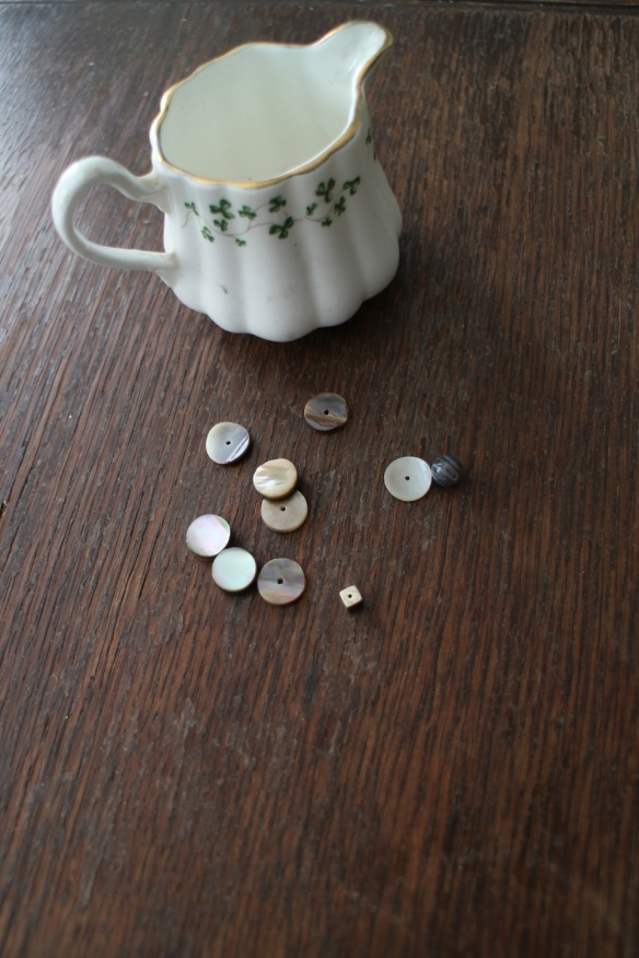Ten little beads, and the little Royal Tara cream pitcher I bought at Malin Head on Inishowen.