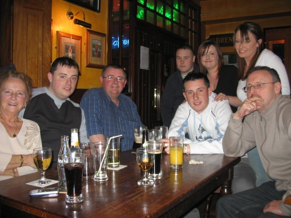 L–R: Front: Bridie, Neil, William, Eoin, Gerry / Back: Kenneth, Clare, Orla. At the Roundabout, 2006.