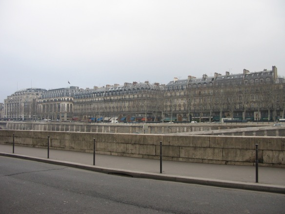 Walking to the north edge of Île de la Cité near the Place Dauphin, looking at the buildings on the other side of the river. On the far left is La Samaritaine, a department store. The other buildings are also shopping emporiums, I believe.